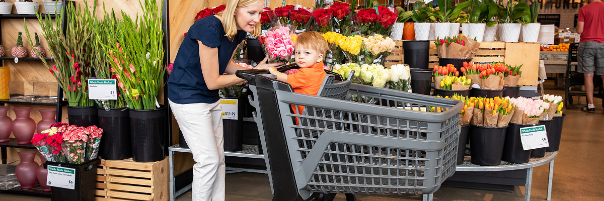 Woman grocery shopping with Bemis Cart